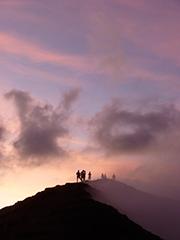image of travellers standing on the rim of Mt Yasur, tanna Vanuatu