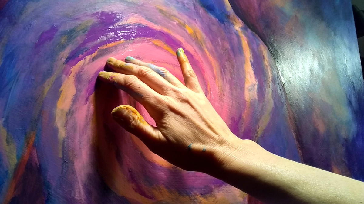 spiral galaxy with hand