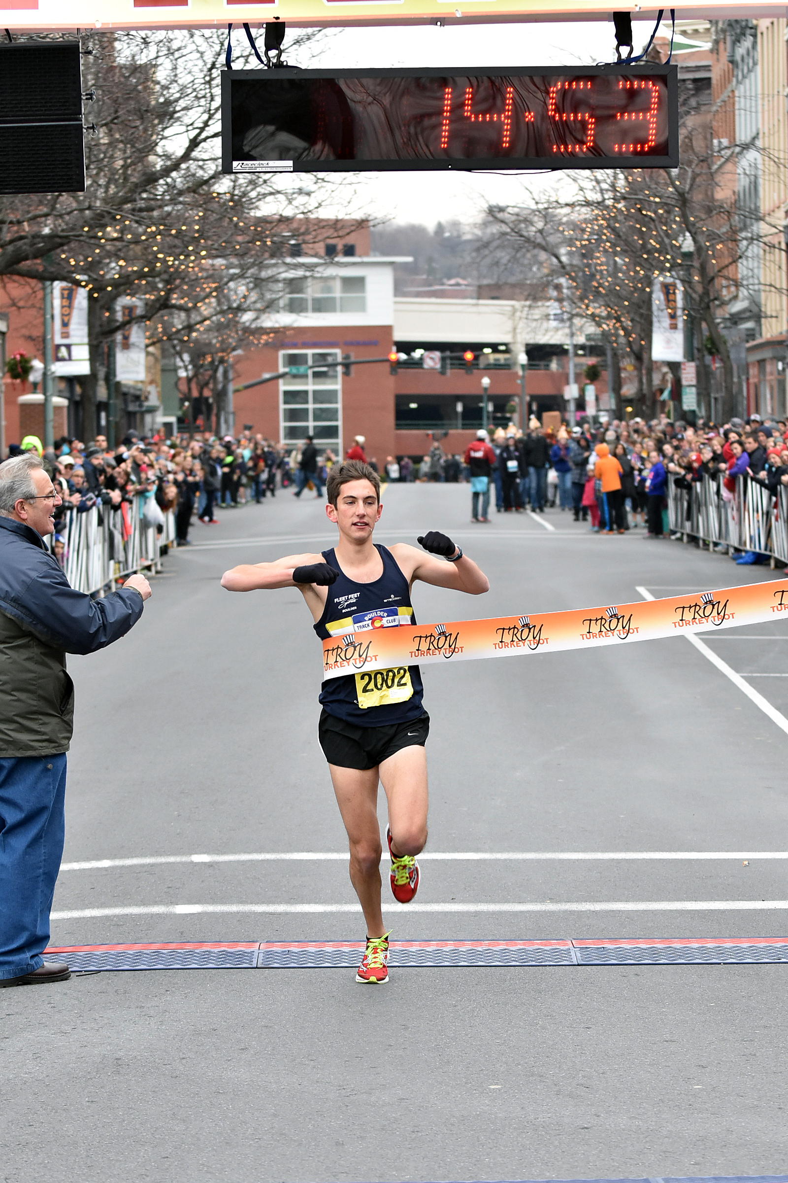 Jonathan Aziz from Boulder, CO runs sub 15 and smashes the 5k course record with a time of 14:53 at the 68th Troy Turkey Trot in Troy, NY. Photo by Pat Hendrick Photography.