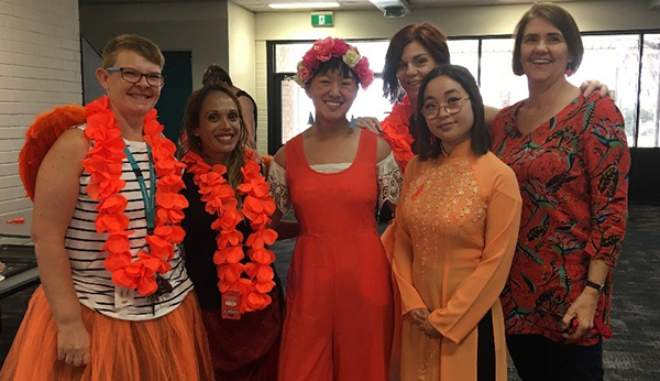Students and staff dressed in orange for Harmony Day