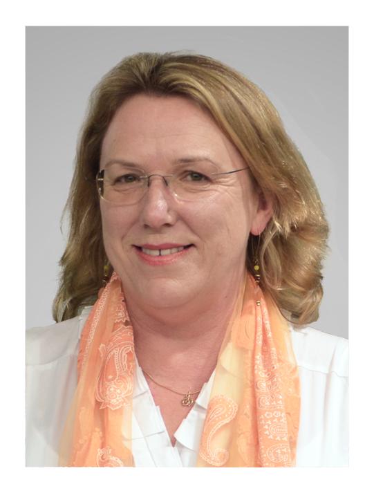 Image description: Blonde woman wearing glasses, smiling.