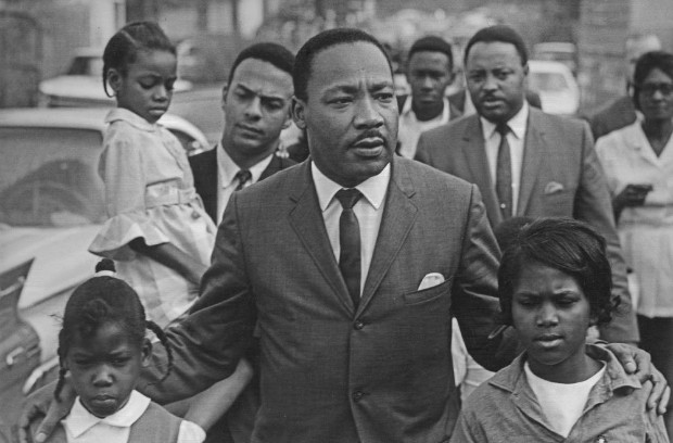 Eva Grace Lemon (7 years old), Martin Luther King Jr., Aretha Willis (7); background Andy Young, Hosea Williams, march to integrate schools, Grenada, MS, 1966. Bob Fitch photography archive -- Martin Luther King Jr. gallery, 1965-1966. Courtesy Stanford Libraries Special Collections Department.