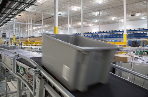 Warehouse tote on conveyor belt