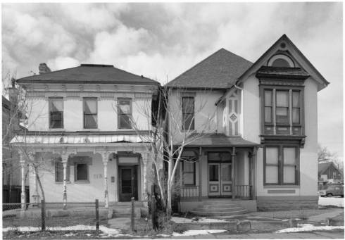 View of houses at 2631-35 California Street in the Five Points Neighborhood of Denver, Colorado. The two story brick homes feature covered porches, spindles, cutwork, dentils, a bay window, and bargeboard. Z-10669