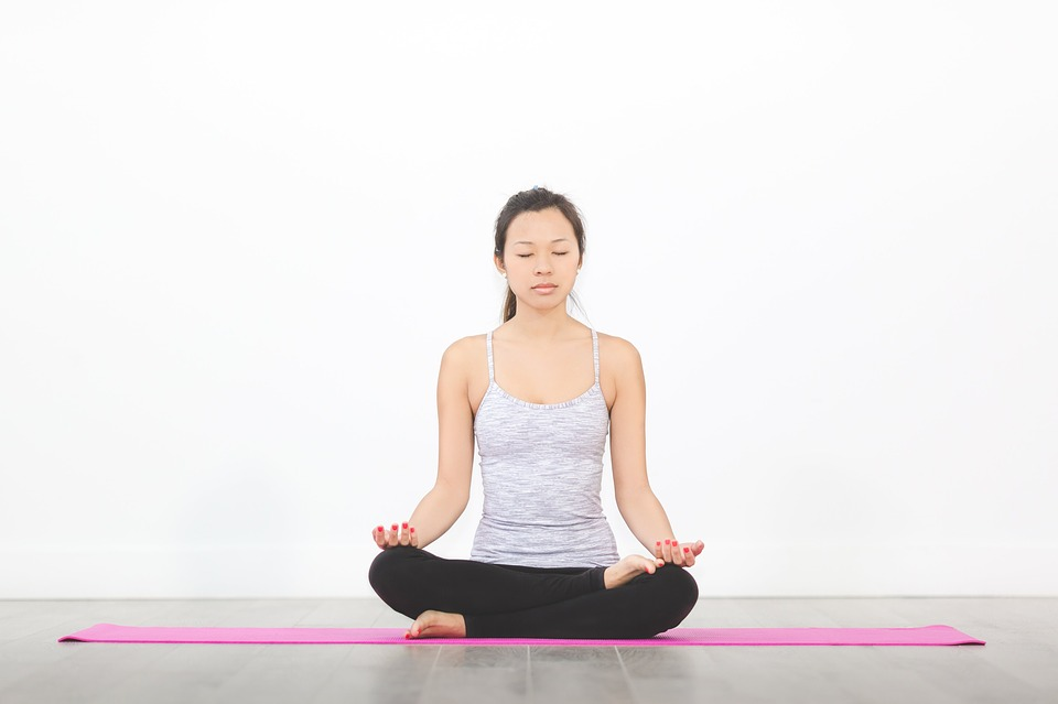Woman Sitting on Yoga Mat