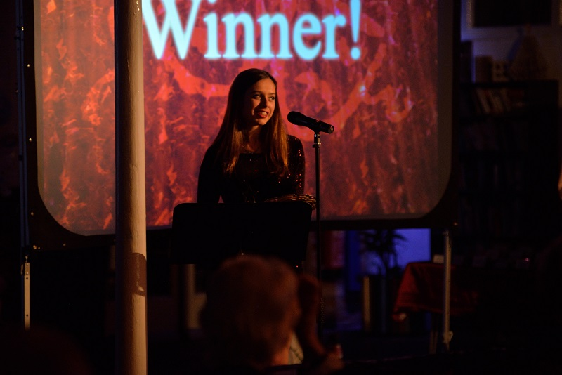 Katie Ireland collects an award for Evita