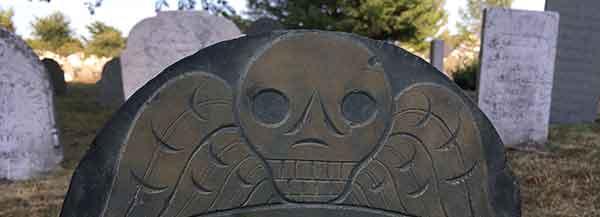 Gravestone art, winged skull