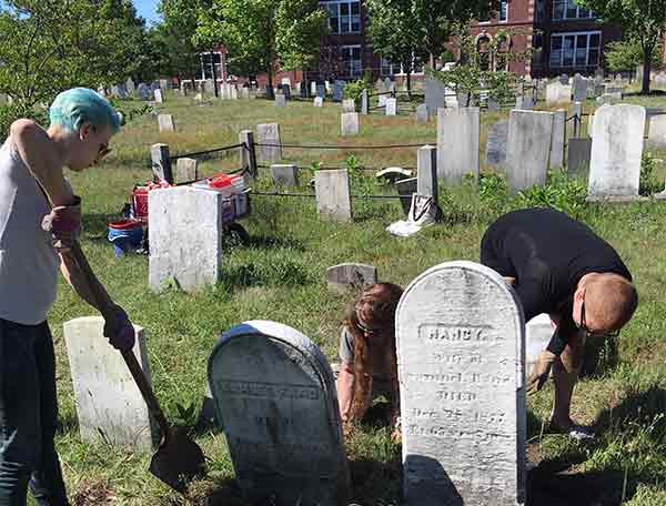 people working in the cemetery