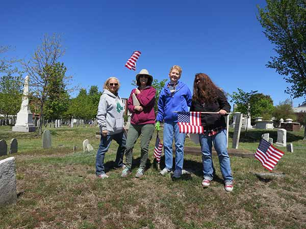 Ladies with American Flags in the Eastern Cemetery