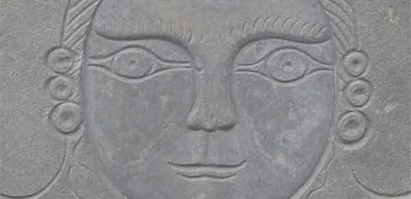 Bartlett Adams carving of a face