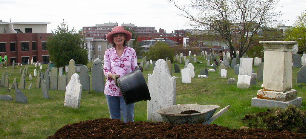 Gardener at mulch pile in Eastern Cemetery