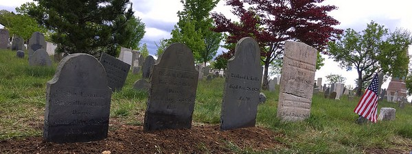 3 slate and 1 marble gravestone cleaned and reset by the conservation team