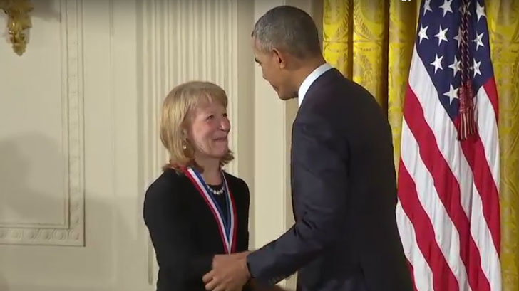 Geri Richmond receiving medal from President Obama