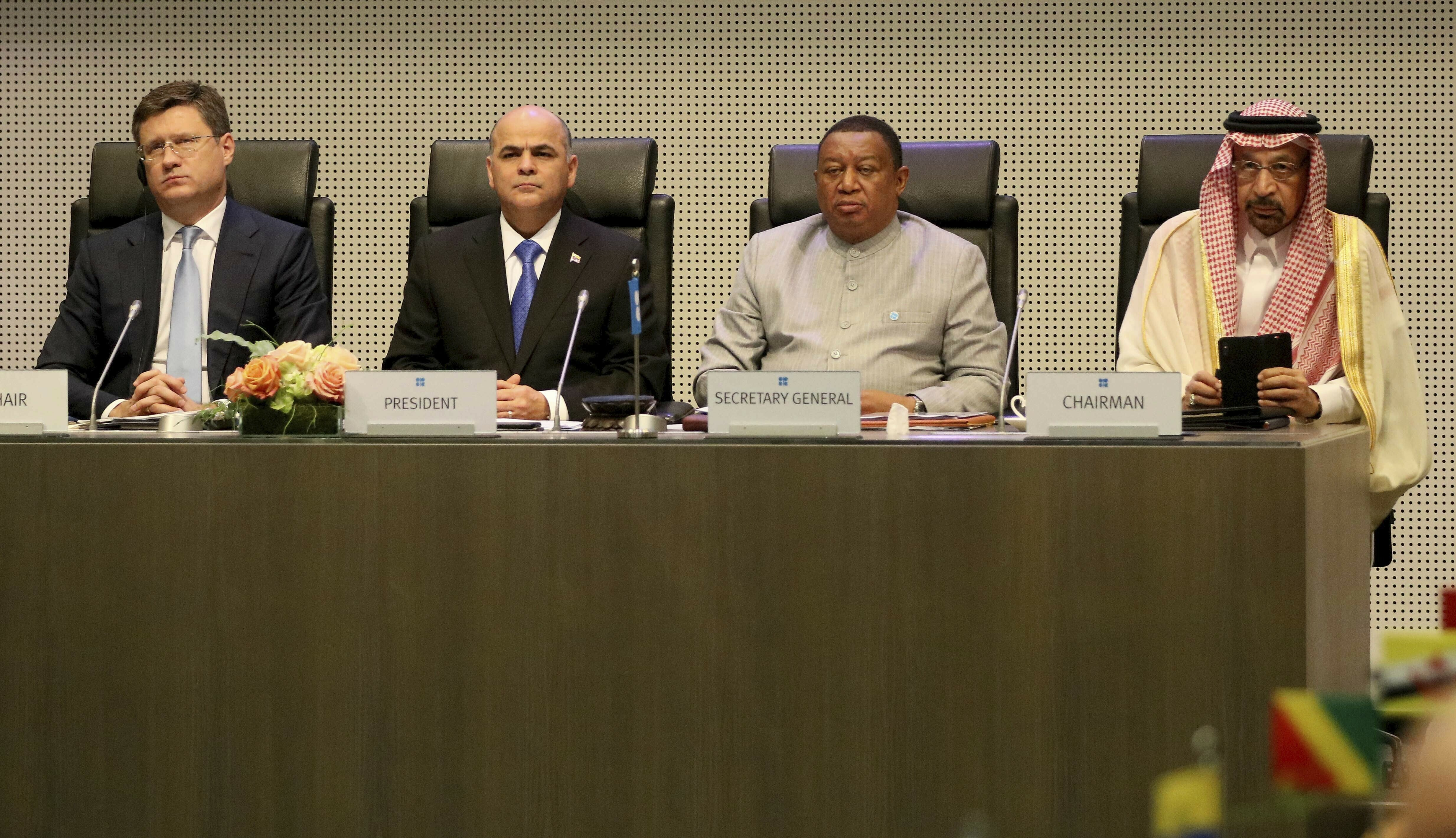 Russian Energy Minister Alexander Novak, Venezuelan Minister of Petroleum Manuel Salvador Quevedo Fernandez, OPEC Secretary General Mohammad Senusi Barkindo, and Saudi Minister of Energy, Industry, and Mineral Resources Khalid al-Falih, from left, wait for the start of a meeting of OPEC and non OPEC members in Vienna, Austria, July 2. (AP Photo/Ronald Zak)