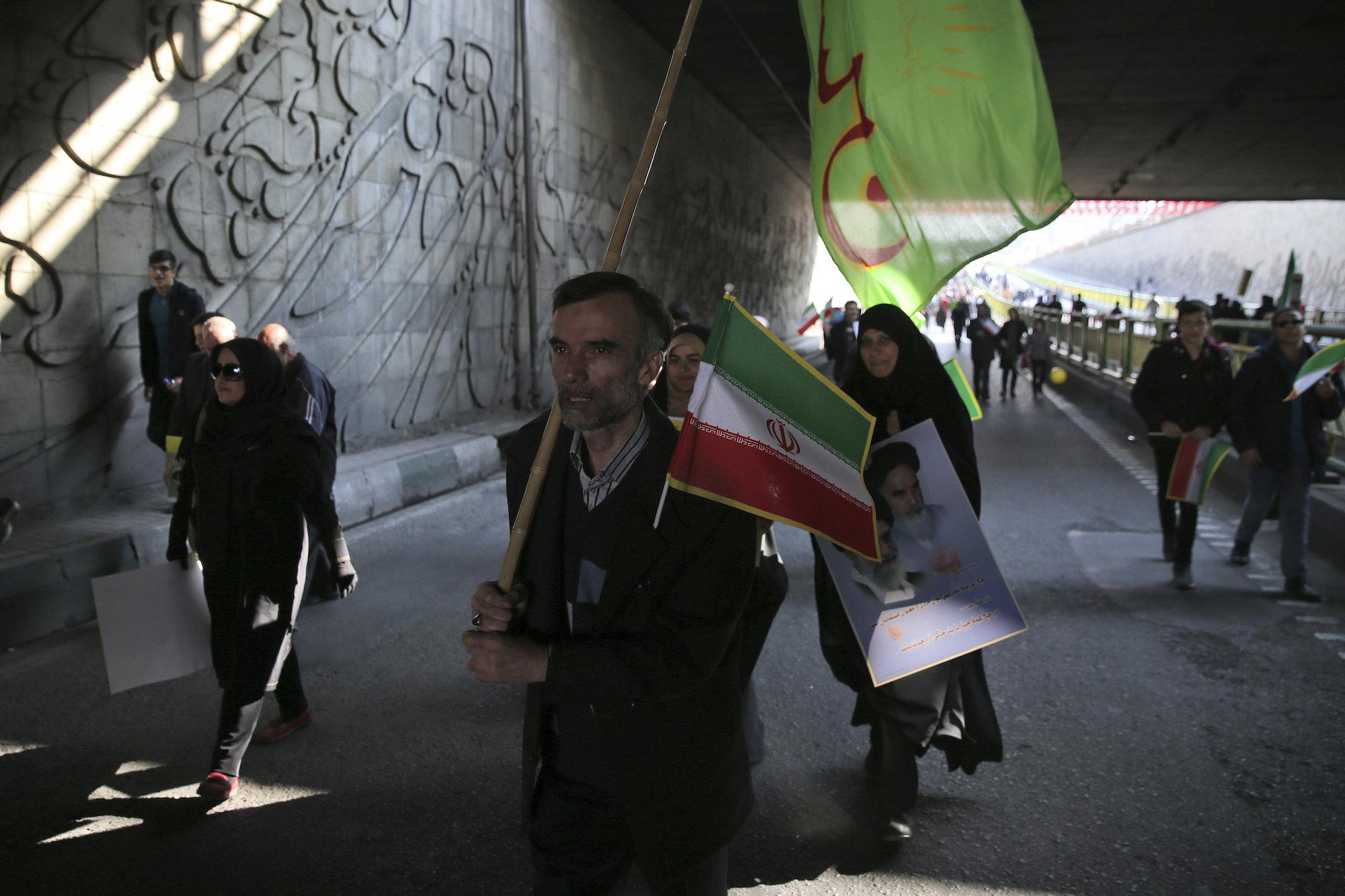 Iranians attend a rally marking the 39th anniversary of the 1979 Islamic Revolution, in Tehran, Iran, Feb. 11, 2018. (AP Photo/Vahid Salemi)