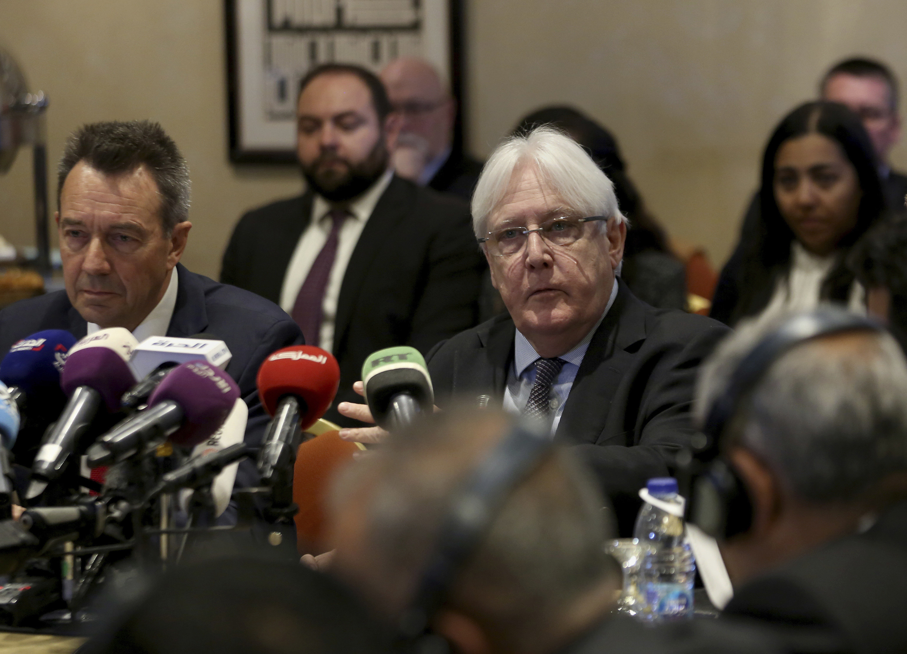 U.N. Special Envoy Martin Griffiths, center, participates in a new round of talks by Yemen's warring parties in Amman, Jordan, Feb. 5. (AP Photo/Raad Adayleh)