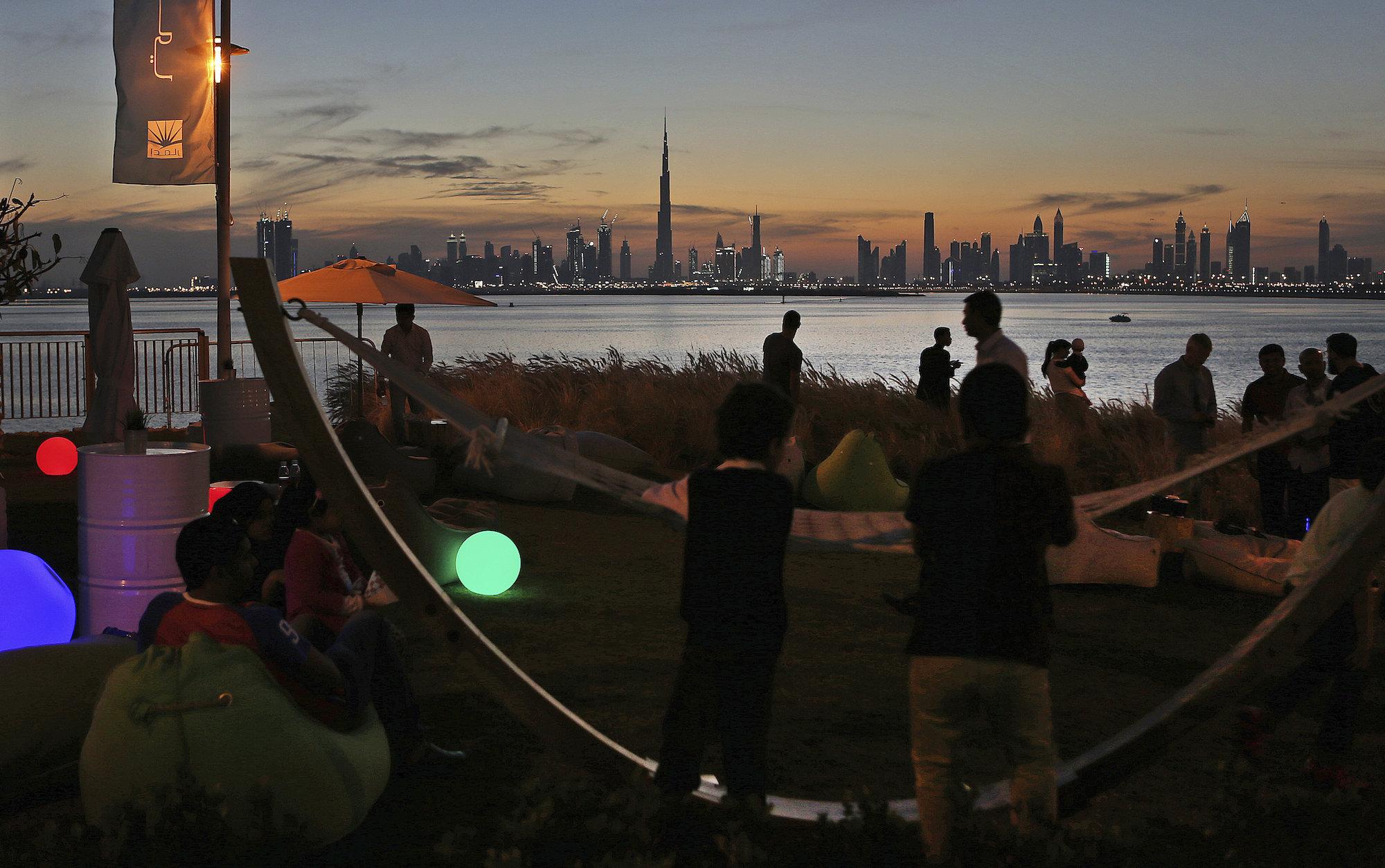 People watch the sunset over the city skyline, Dubai, United Arab Emirates, March 4, 2016. (AP Photo/Kamran Jebreili)