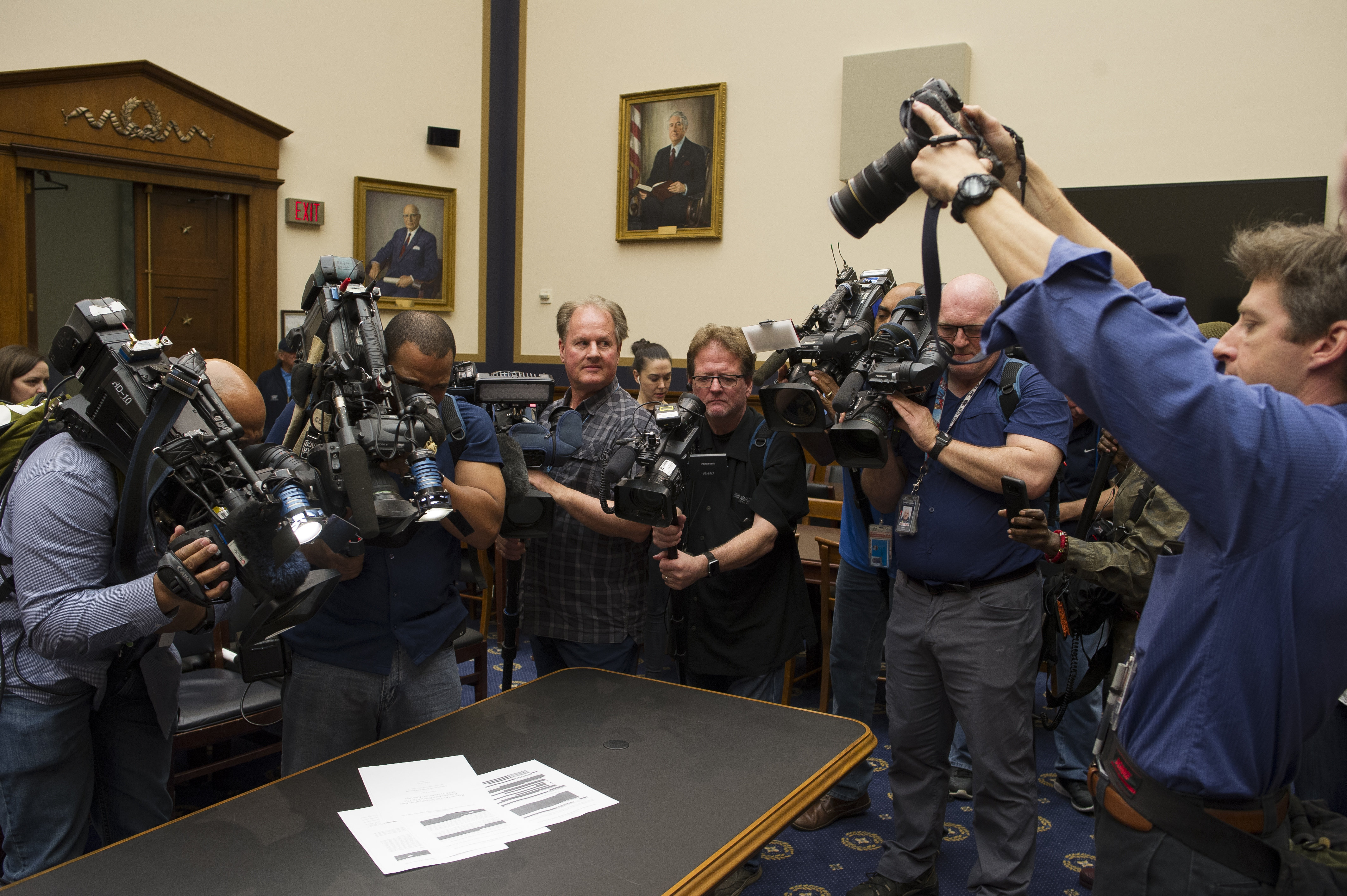 Photojournalists photograph four pages of the Mueller report laid on the witness table in the House Intelligence Committee hearing room on Capitol Hill, in Washington, DC, April 18. (AP Photo/Cliff Owen)