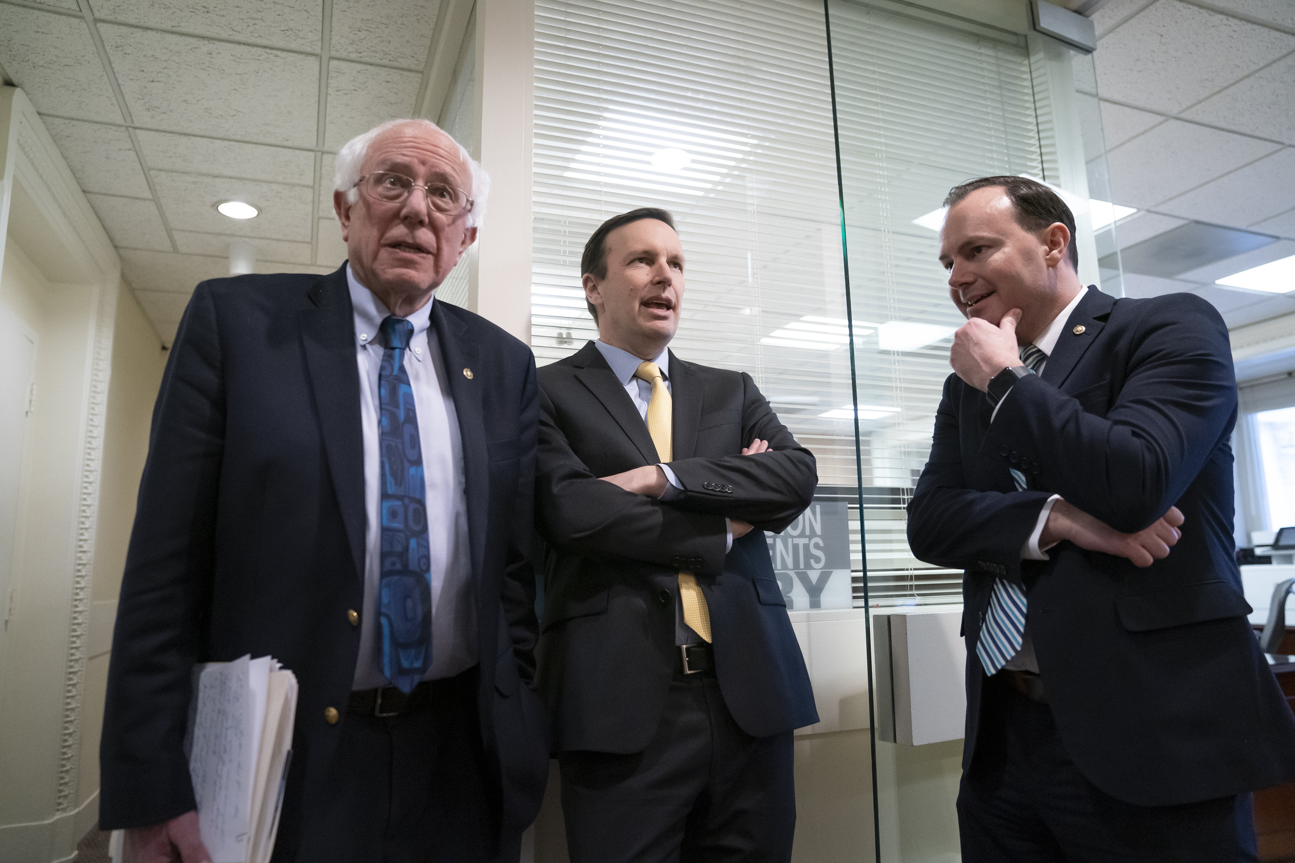 Democratic Senator Bernie Sanders, Democratic Senator Chris Murphy, and Republican Senator Mike Lee meet before holding a news conference on the Senate vote on ending U.S. support for the Saudi-led coalition fighting in Yemen, at the Capitol in Washington, DC, March 13. (AP Photo/J. Scott Applewhite)