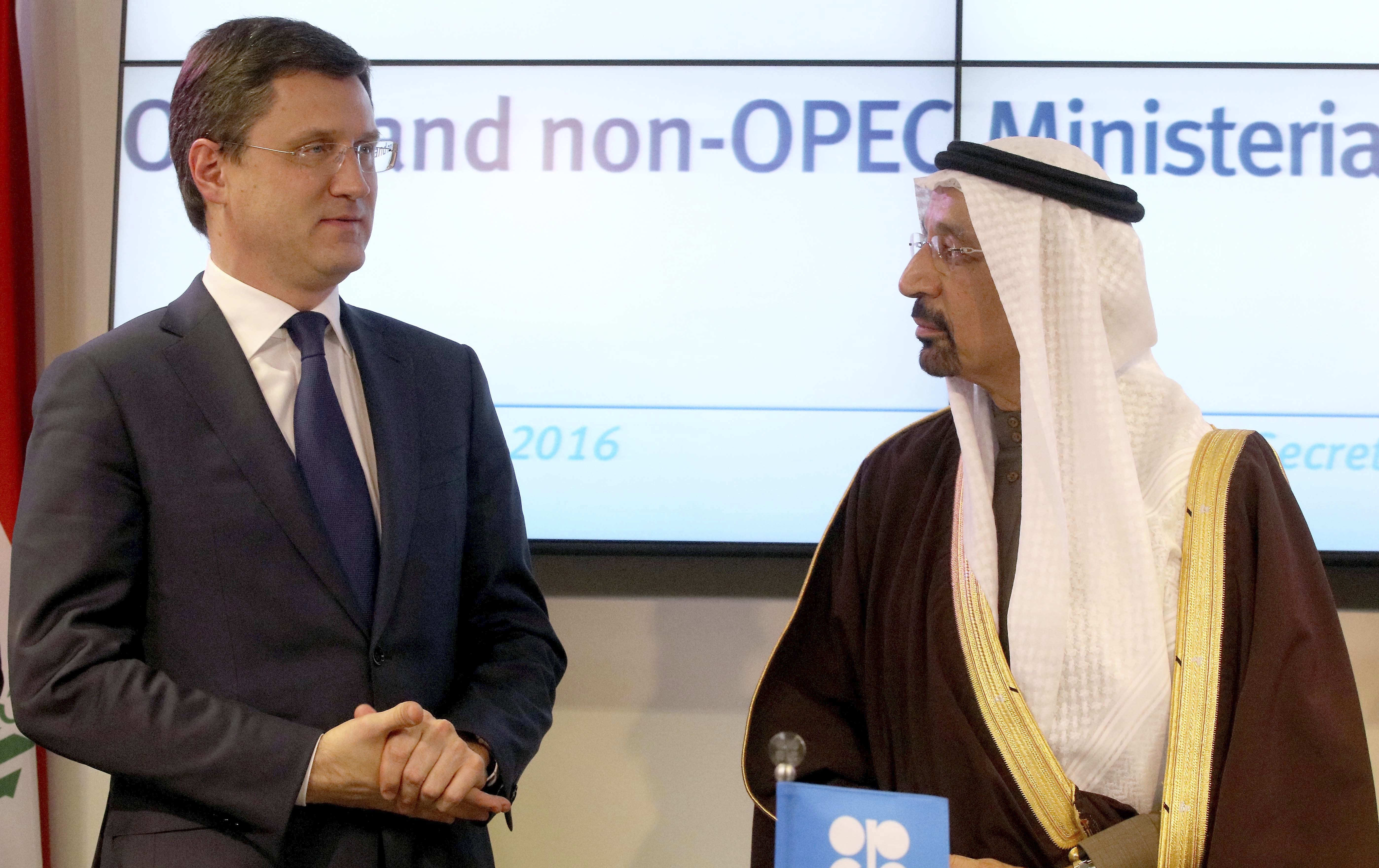 Russian Energy Minister Alexander Novak, left, and Saudi Minister of Energy, Industry, and Mineral Resources Khalid al-Falih at a news conference after a meeting of OPEC in Vienna, Austria, Dec. 10, 2016. (AP Photo/Ronald Zak)