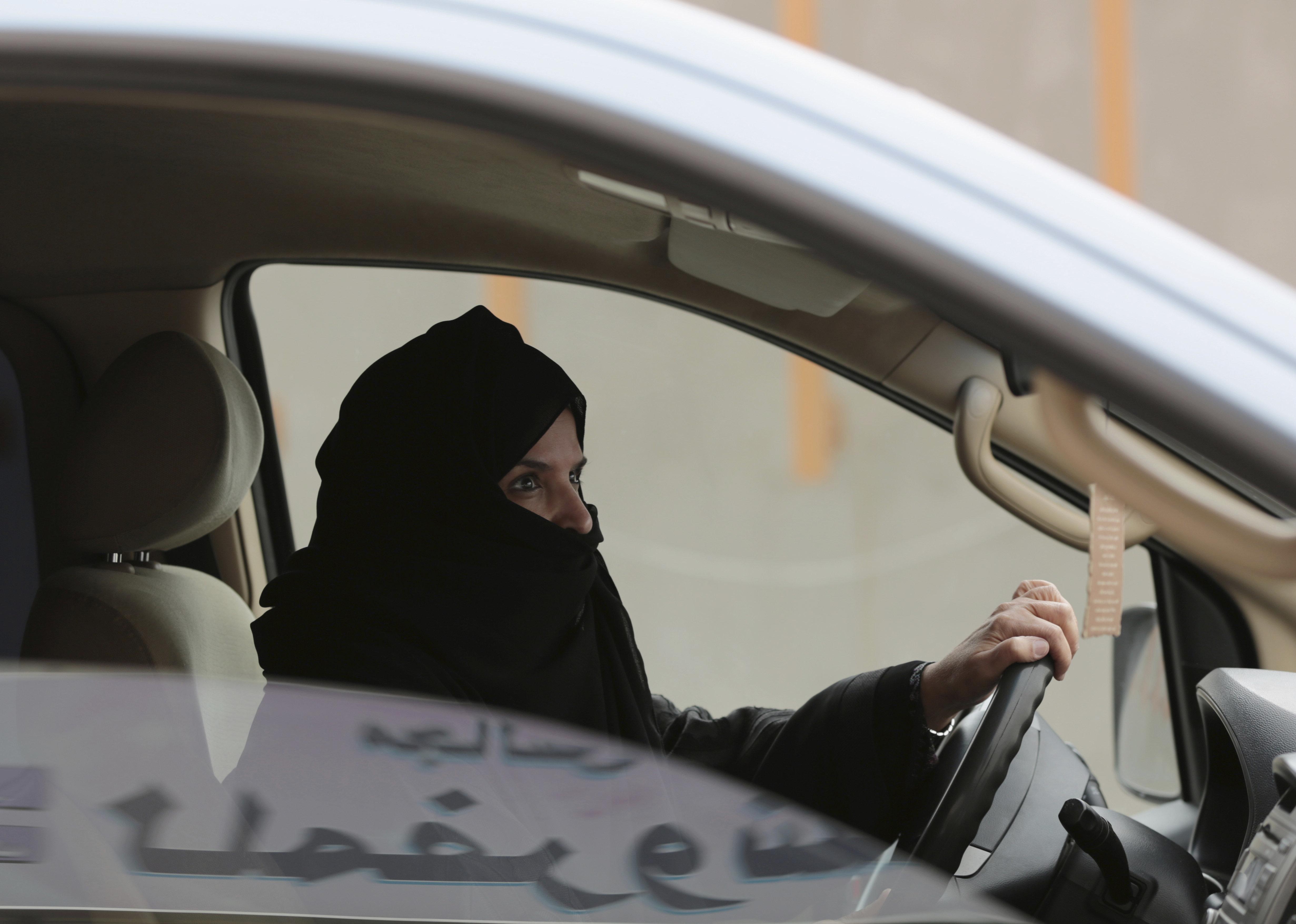 Saudi activist Aziza al-Yousef drives a car on a highway in Riyadh, Saudi Arabia, as part of a campaign to defy Saudi Arabia's then ban on women driving, March 29, 2014. (AP Photo/Hasan Jamali)