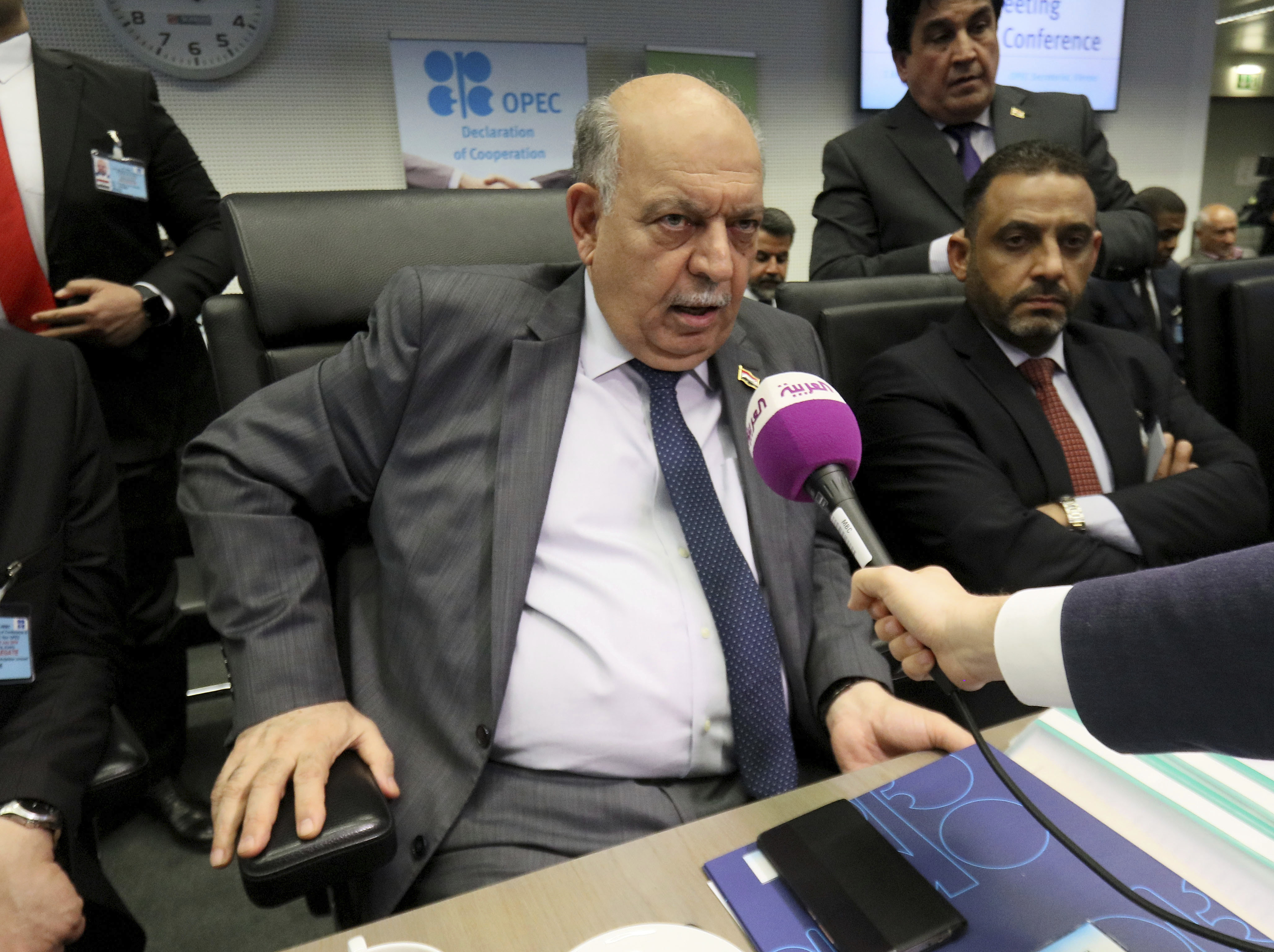 Iraqi Deputy Prime Minister for Energy Affairs and Oil Minister Thamir Ghadhban speaks prior to the start of an OPEC meeting in Vienna, Austria, July 1. (AP Photo/Ronald Zak)