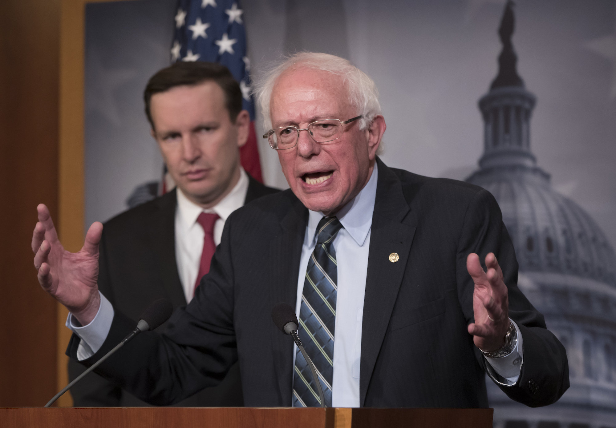 Senator Bernie Sanders, a Democrat from Vermont, joined at left by Senator Chris Murphy, a Democrat from Connecticut, holds a news conference after the Senate passed a resolution that would pull U.S. assistance from the Saudi-led coalition in Yemen, at the Capitol in Washington, DC, Dec. 13, 2018. (AP Photo/J. Scott Applewhite)