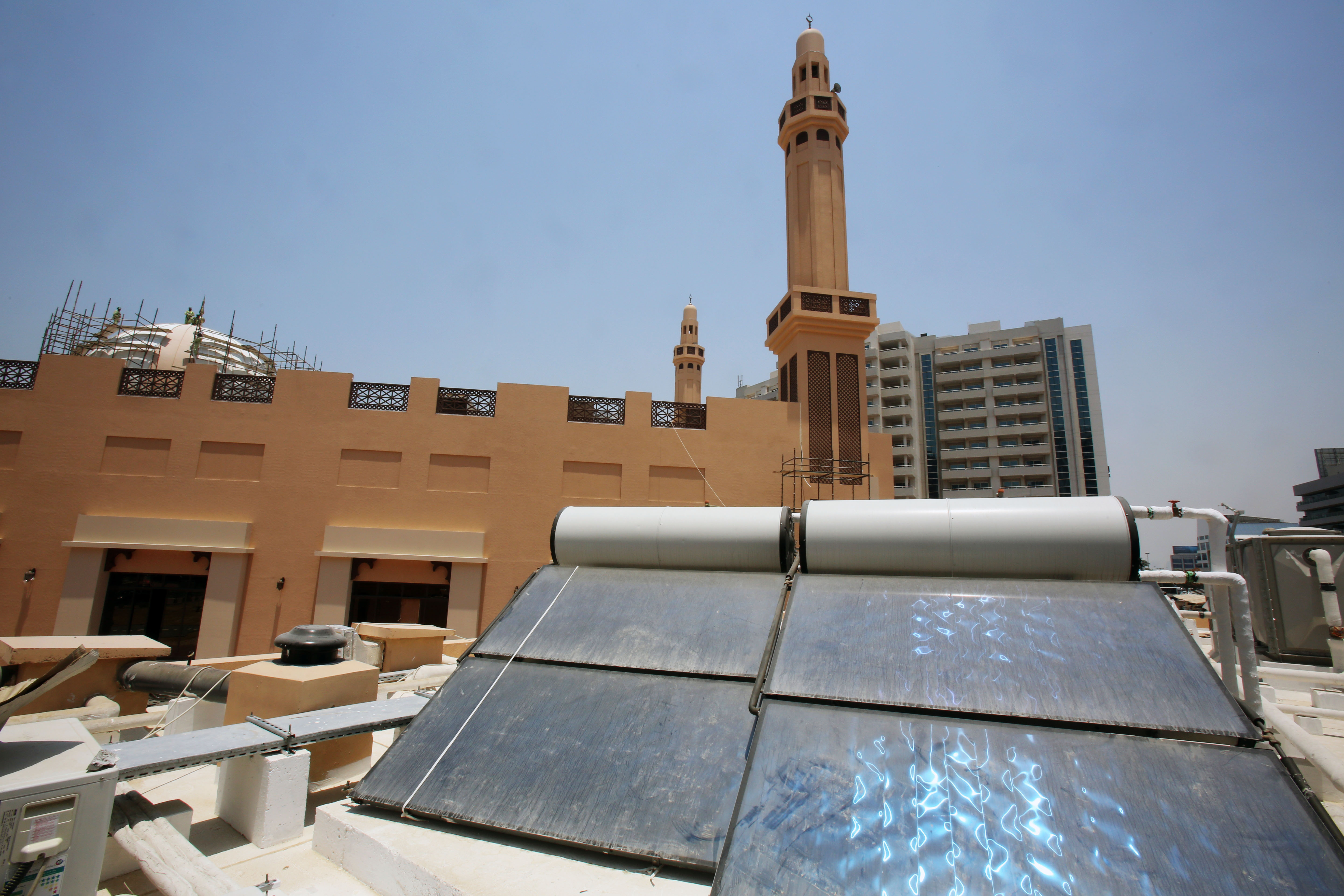 Solar panels are set on the roof of the first green mosque in Dubai, United Arab Emirates, May 18, 2014. (AP Photo/Kamran Jebreili)