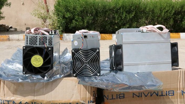 Boxes of machinery used in bitcoin mining operations, confiscated by police in Nazarabad, Iran (News.police.ir via AP)