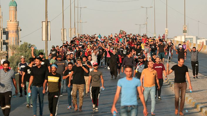 Protesters during a demonstration in Baghdad, Iraq, Oct. 3. (AP Photo/Hadi Mizban)