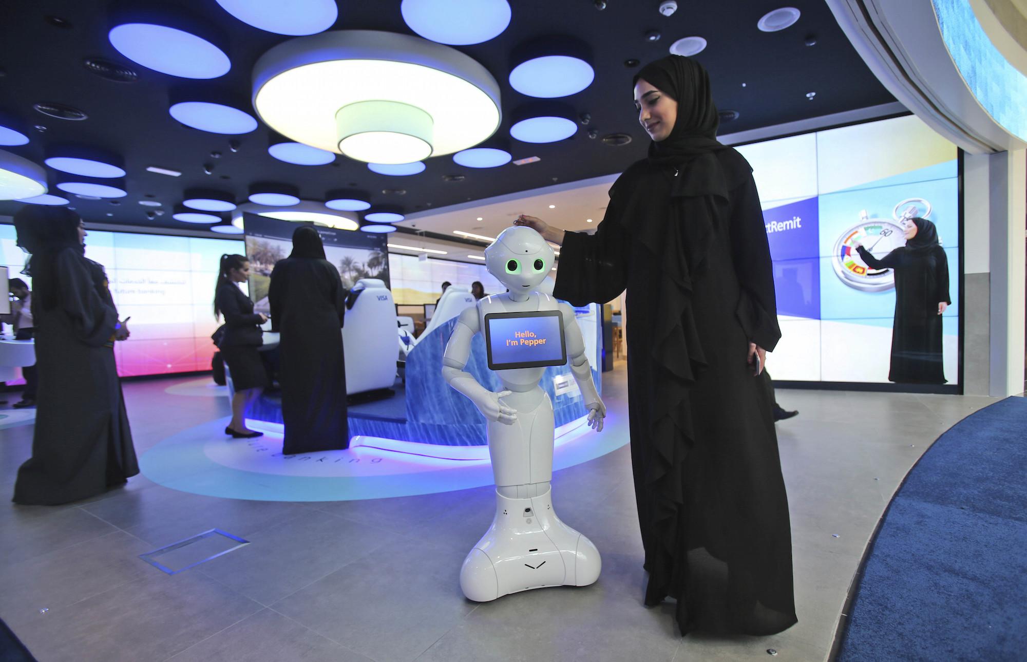 Emirati Woman Presents Pepper the Robot