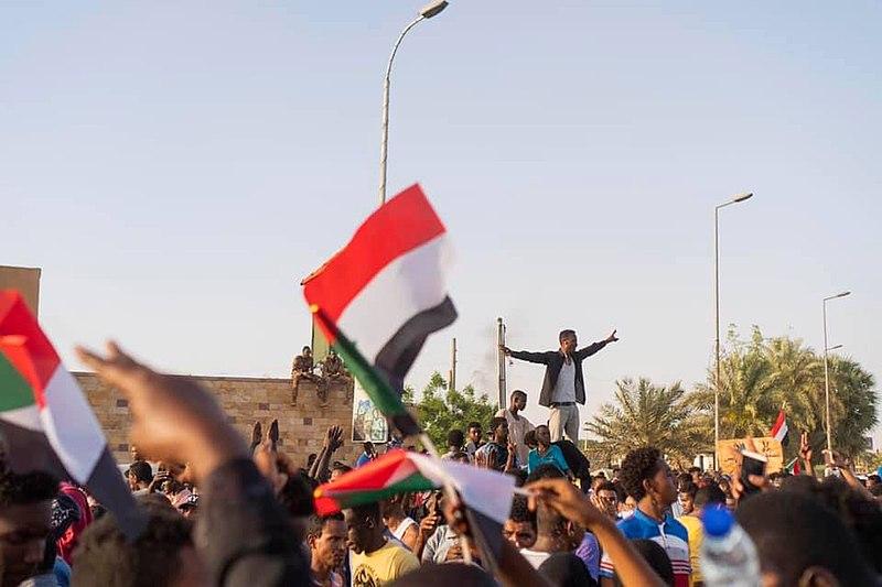Sudanese protestors chanting (Wikimedia Commons)