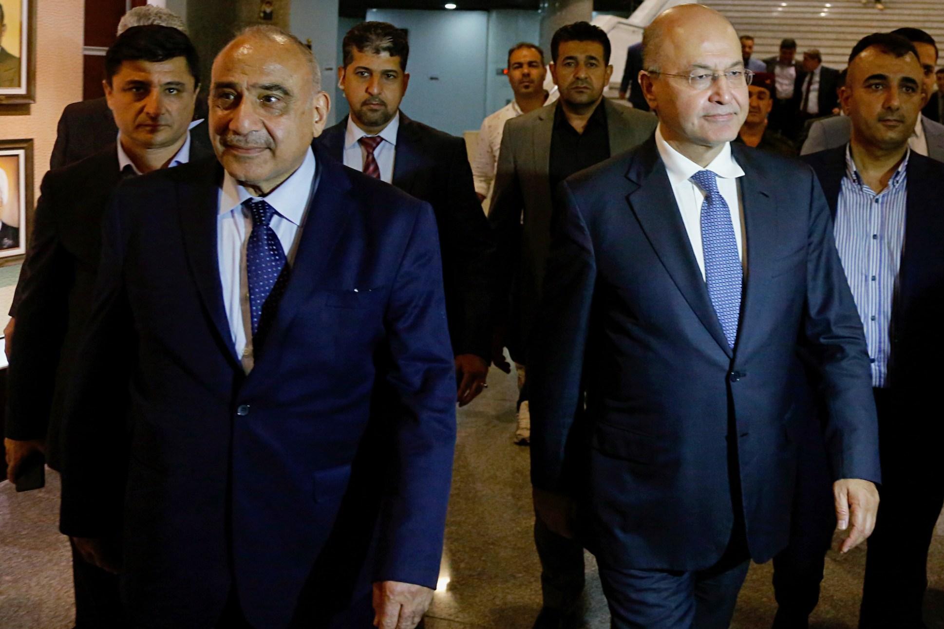 Newly elected Iraqi President Barham Salih with newly elected prime minister Adel Abdul Mahdi