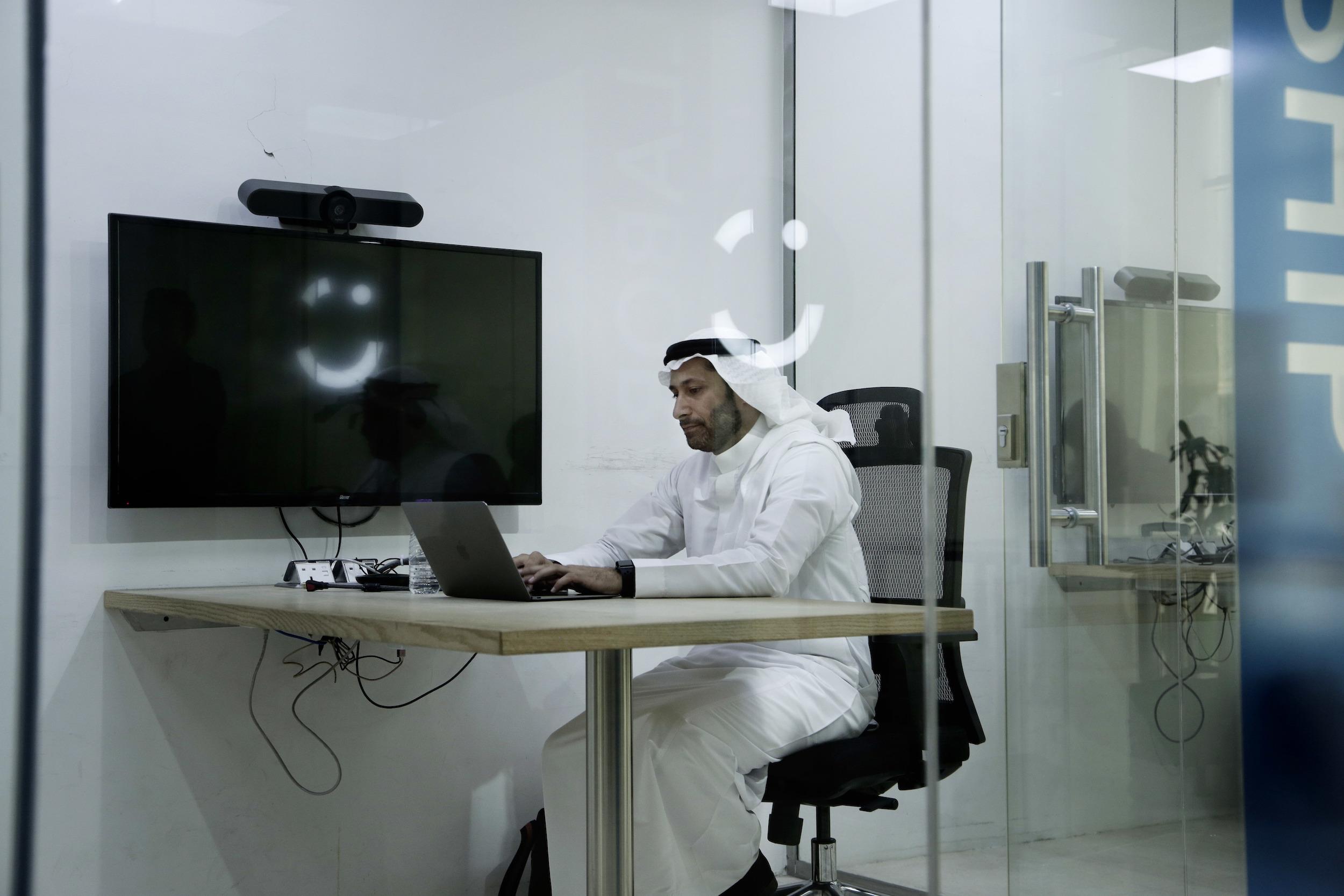 Careem co-founder Abdullah Elyas sits at a desk at Careem's office in Riyadh, Saudi Arabia, June 24, 2018. (AP Photo/Nariman El-Mofty)