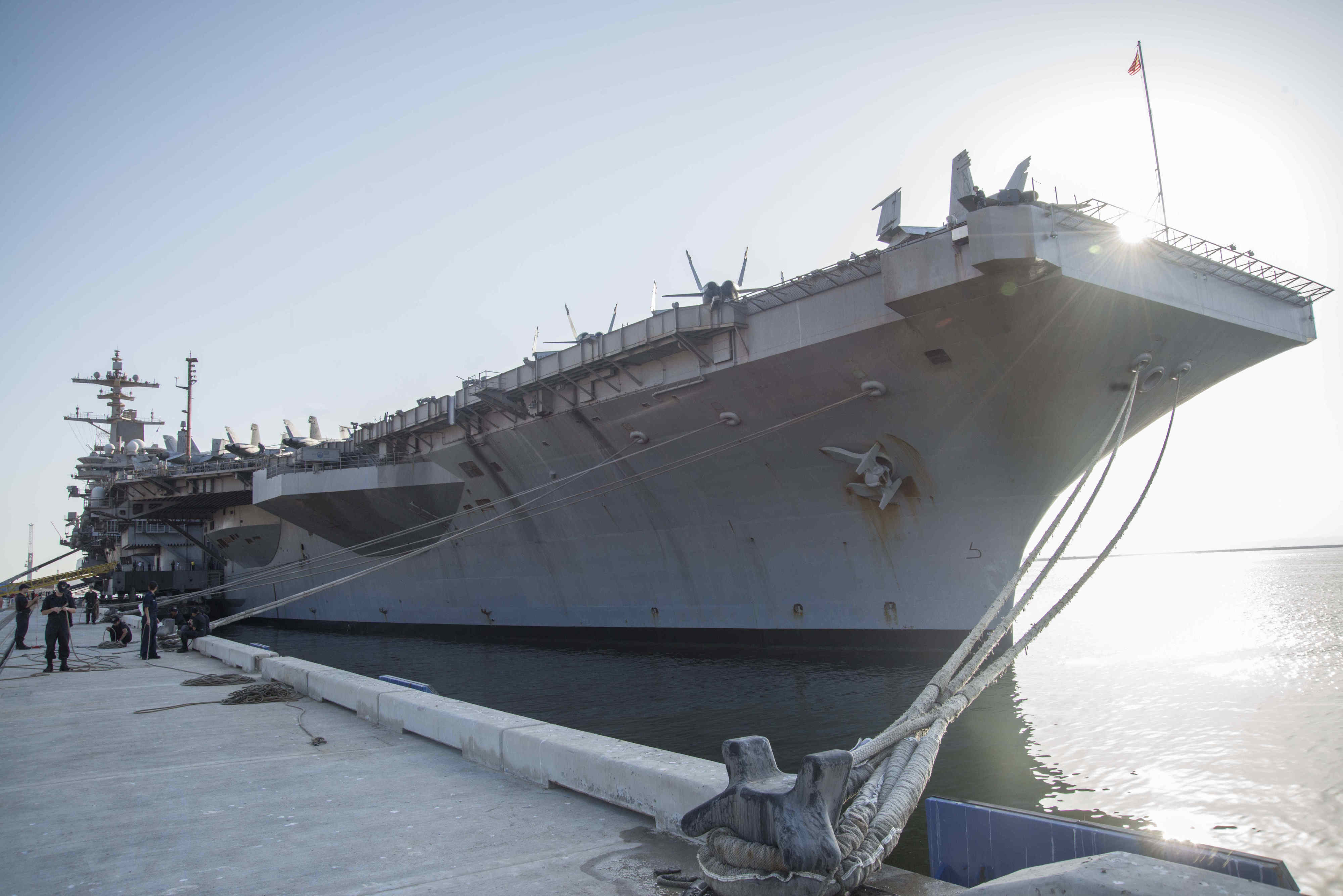 The aircraft carrier USS George H.W. Bush docks in the port of Duqm, Oman, October 21, 2014. (U.S. Navy photo by Mass Communication Specialist 3rd Class Preston Paglinawan/ Released)