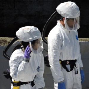 man and woman in protective suits and hoods