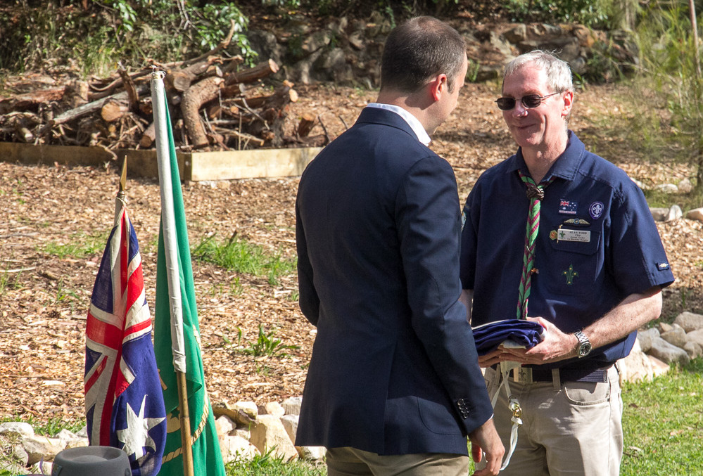Matt Kean handing over a NSW flag to Chip