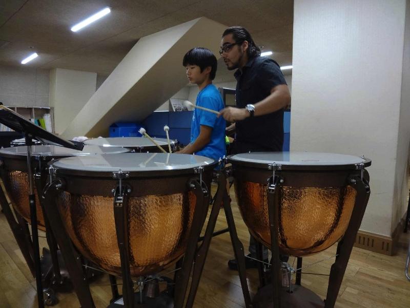 Camacho teaching Korean percussion student