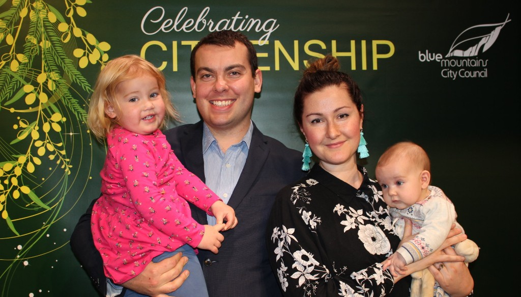 Olive, Charlotte and Poppy Vance (pictured left to right) watched their father and partner Adam Vance become an Australian citizen.