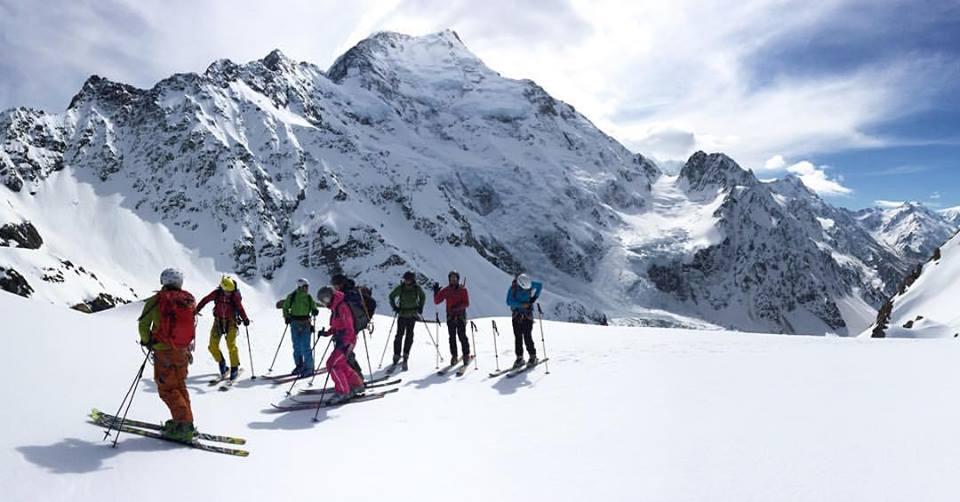 Ski tourers admiring the view of Aoraki / Mt. Cook from Ball Ridge