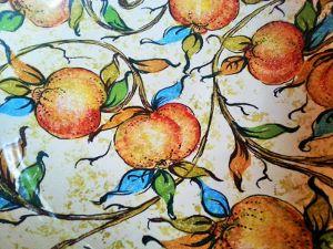 Ceramic bowl painted with oranges