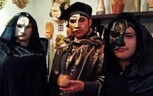 Wearing Venetian half masks