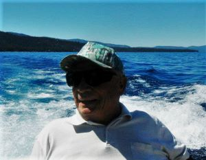 Dad in boat on Lake Tahoe