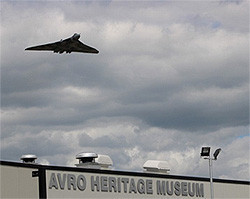 Vulcan flying over the AVRO Heritage Museum at Woodford