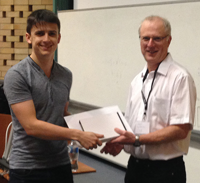 RCC Director Prof David Abramson presents the John Makepeace Bennett Award to PhD student Joey Scarr