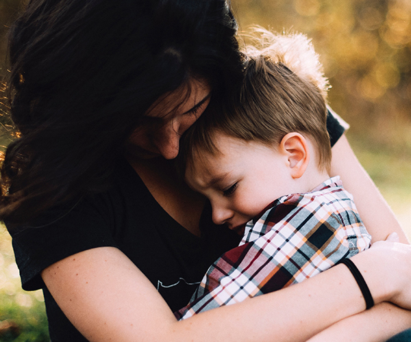 Woman Embracing Child