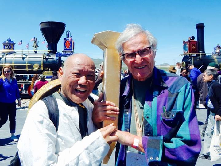 Patick Goggins with ceremonial golden spike
