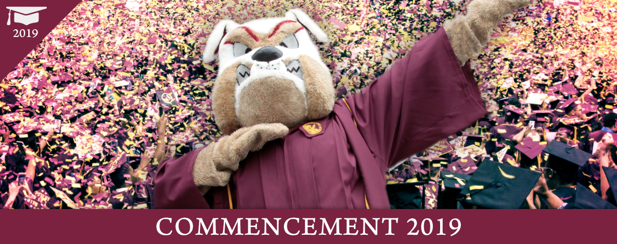 Buster Bulldog dabs at the Brooklyn College Commencement, 2018. Front text: Commencement 2019