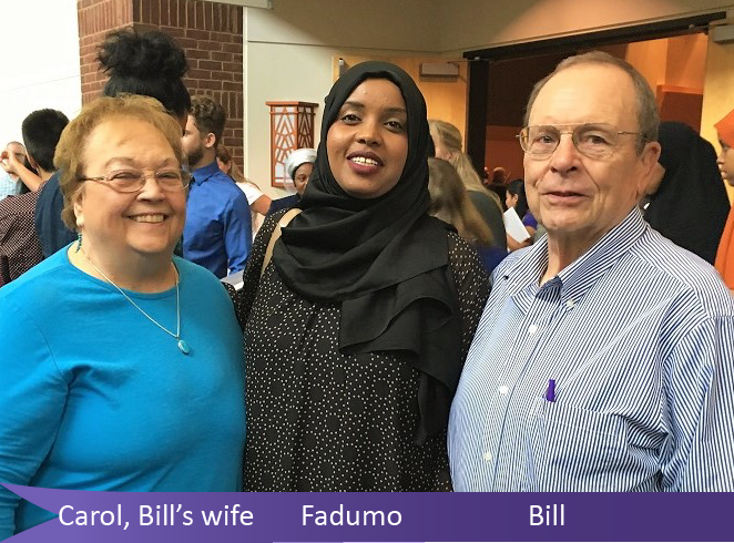 A picture of volunteer tutor Bill, his wife Carol and student Fadumo