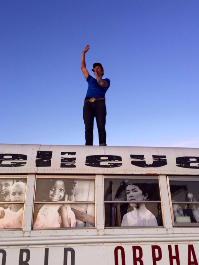 Aaron Boyd of Bluetree speaking about World Orphans from atop a bus